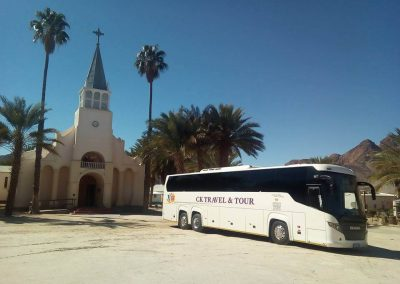 48 Seater Scania Bus Outside Church